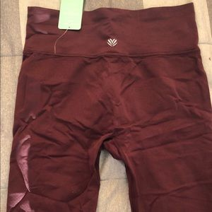 Burgundy spandex material workout leggings.